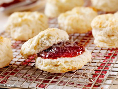 Homemade Buttermilk Biscuits Cooling on a rack in the Kitchen with Strawberry Jam- Photographed on Hasselblad H3D2-39mb Camera