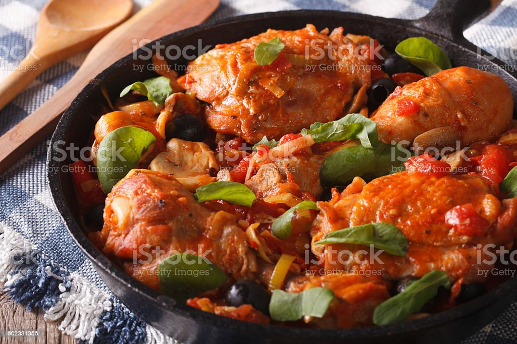 Homemade Cacciatori chicken with mushrooms in a pan horizontal stock photo