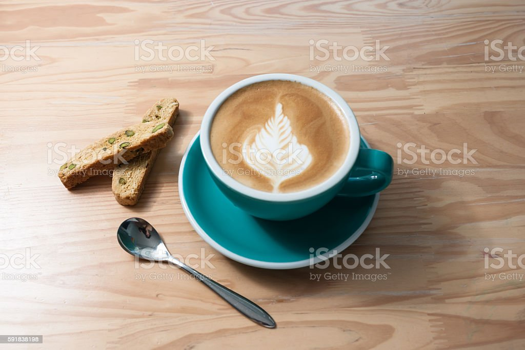 Homemade Cafe Latte with Biscotti on wooden table. stock photo