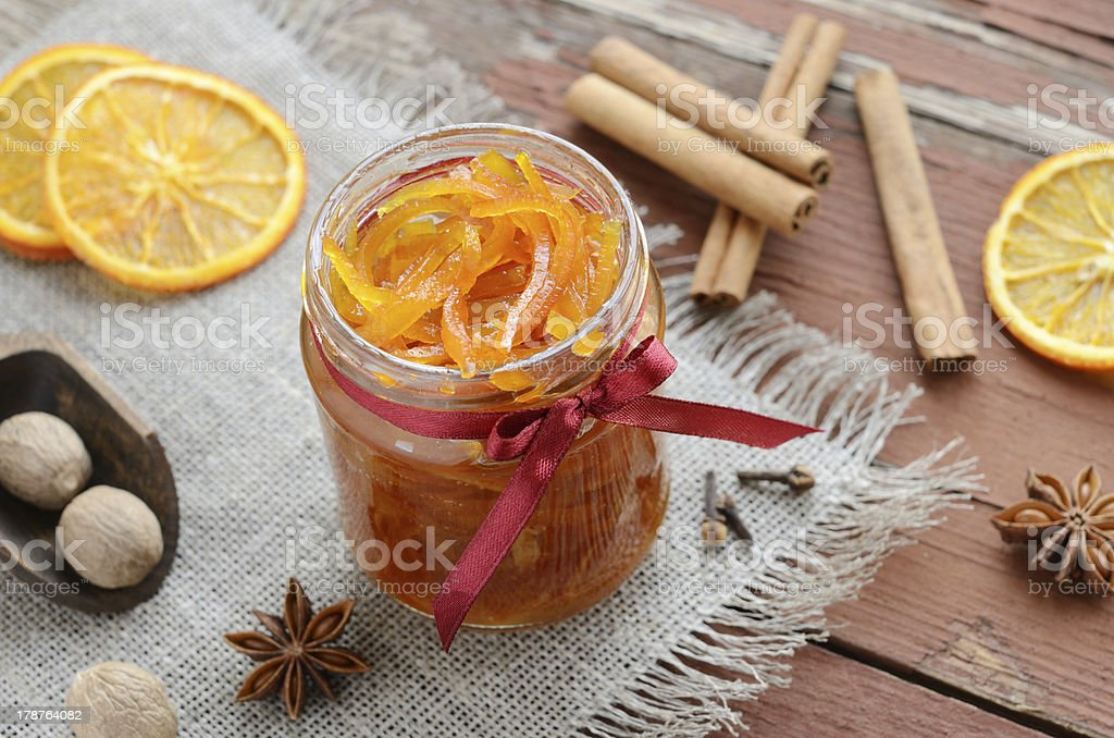 Homemade candied peels orange jam in glass jar royalty-free stock photo
