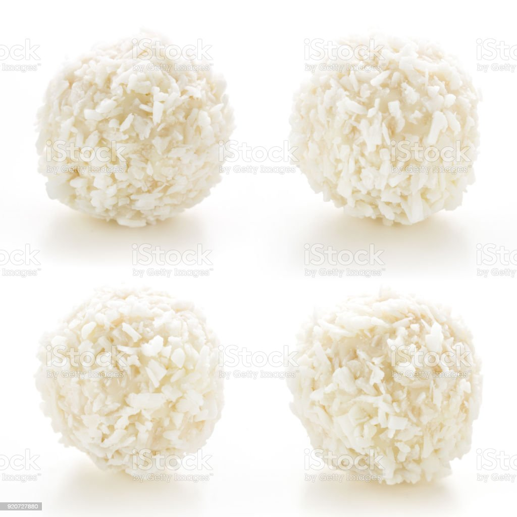 Homemade candy white chocolate and coconut on a plate on white isolated background. Set Candy  truffles snowball. Selective focus stock photo
