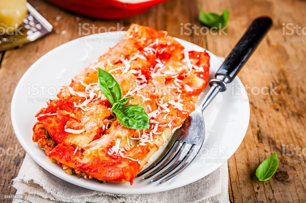 Homemade cannelloni with spinach and tomato sauce stock photo