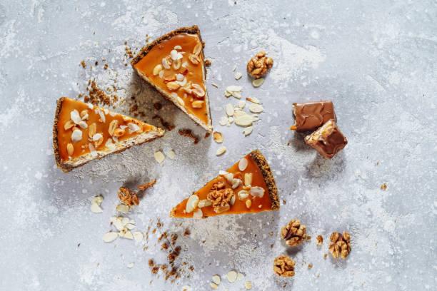 Homemade Caramel and Peanut Cheesecake Flat Lay stock photo