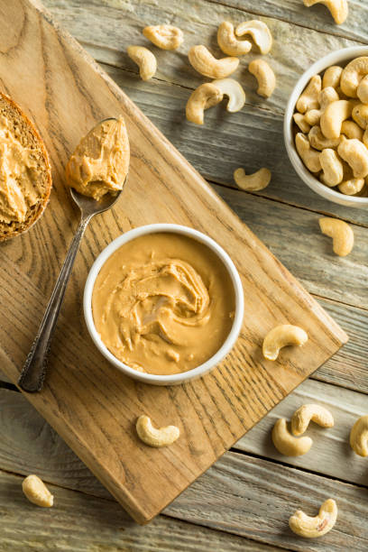 homemade cashew peanut butter - cashew stock photos and pictures