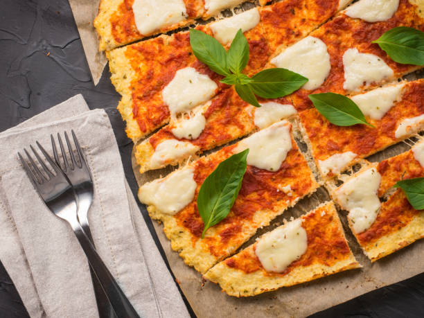homemade cauliflower pizza crust with mozarella stock photo