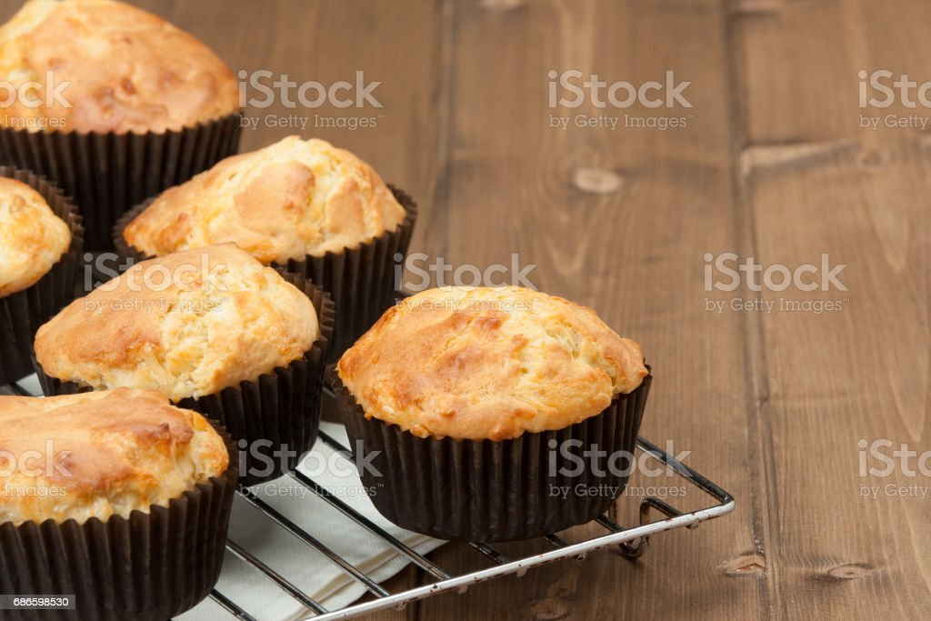 Homemade Cheddar Muffins In Paper Cases. Wooden Table. royalty-free stock photo