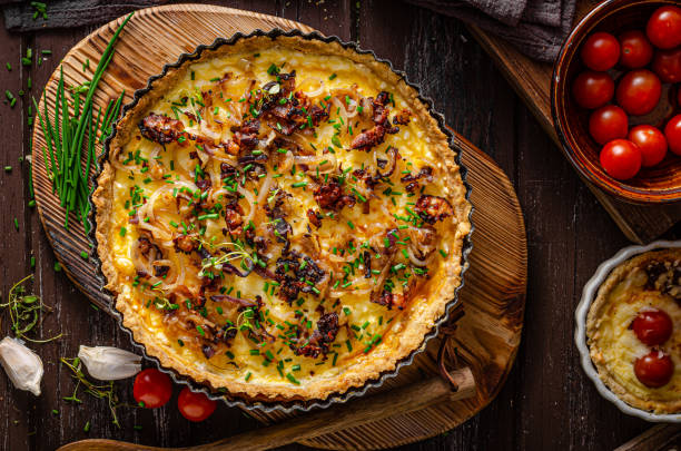 Homemade cheese quiche with onion and bacon stock photo