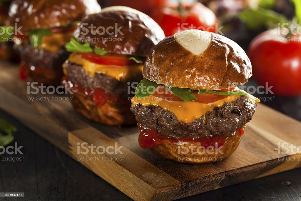 Homemade Cheeseburger Sliders with Lettuce and Cheese stock photo