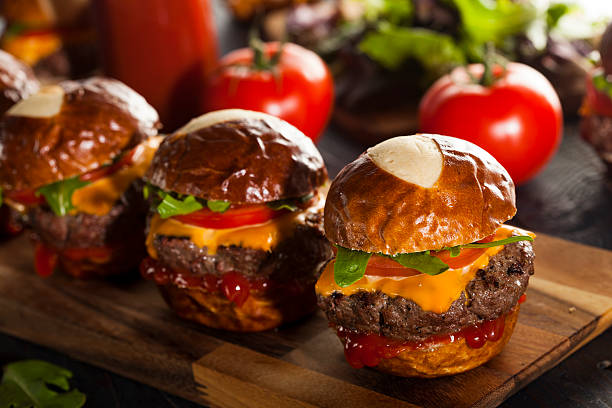 Homemade Cheeseburger Sliders with Lettuce and Cheese Homemade Cheeseburger Sliders with Lettuce Tomato and Cheese slider burger stock pictures, royalty-free photos & images