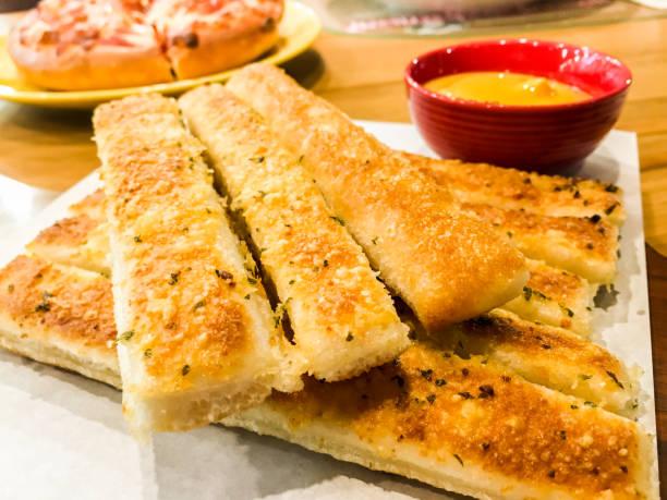 Homemade Cheesy Breadsticks stock photo