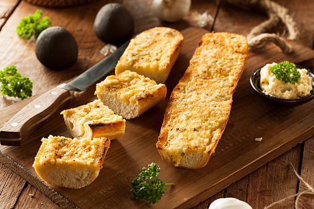 Homemade Cheesy Garlic Bread stock photo