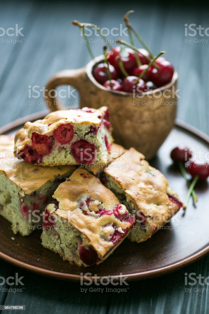 Homemade cherry pie on a plate and wood background royalty-free stock photo