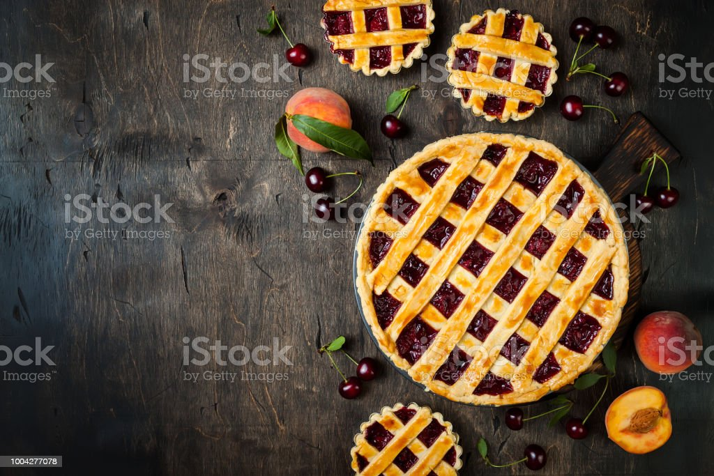 Homemade cherry pie on rustic wooden background royalty-free stock photo