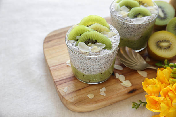 homemade chia pudding with kiwi and almond slices, easter breakf - chia pudding kokosmilch stock-fotos und bilder