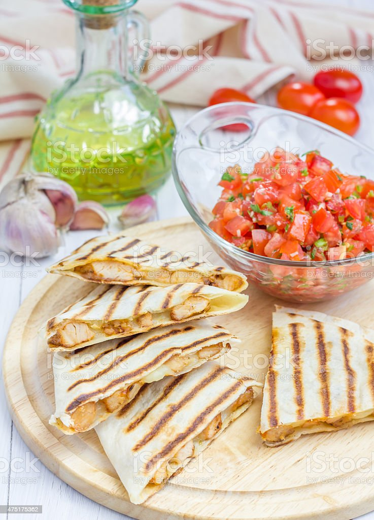Homemade chicken and cheese quesadilla with salsa stock photo