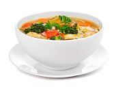 Homemade chicken vegetable soup isolated on white