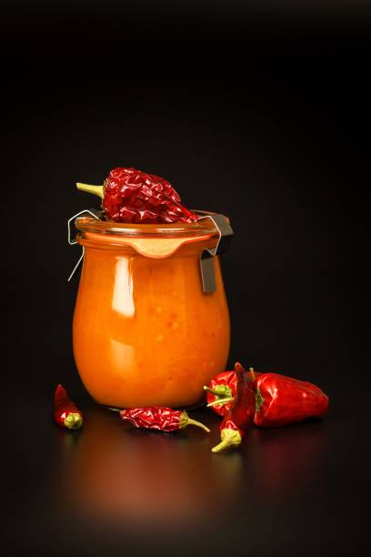 homemade chilli sauce on a black background. sale of spices. ingredients for cooking. - confiture tomatoes imagens e fotografias de stock