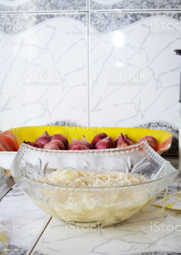 Homemade chinese soup pasta with onions royalty-free stock photo