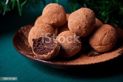 istock homemade chocolate balls truffles on the plate. 1292101051