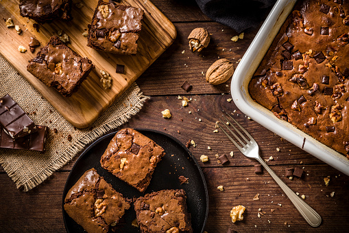 Homemade chocolate brownie on a rustic wooden table