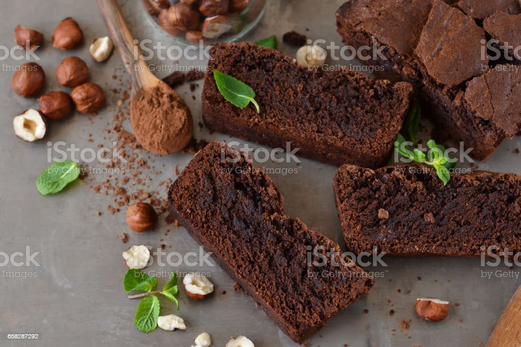 Homemade chocolate brownies with nuts on a metal, grunge background stock photo