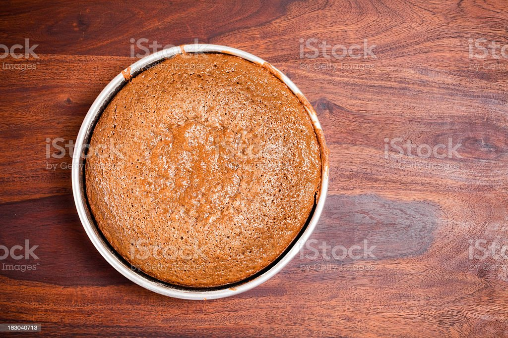 Homemade Chocolate Cake placed on the Wooden Table royalty-free stock photo