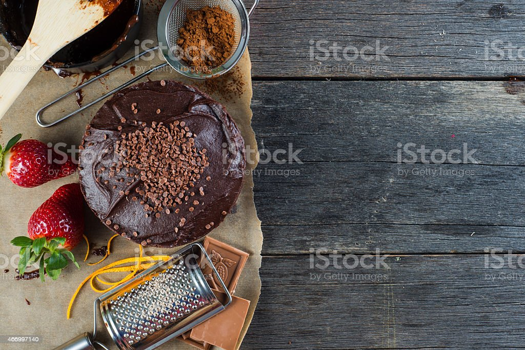 homemade chocolate cake recipe border background from above stock photo