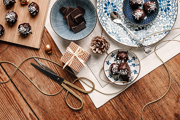 homemade chocolate candy gift overhead table top - blue table setting stock photos and pictures