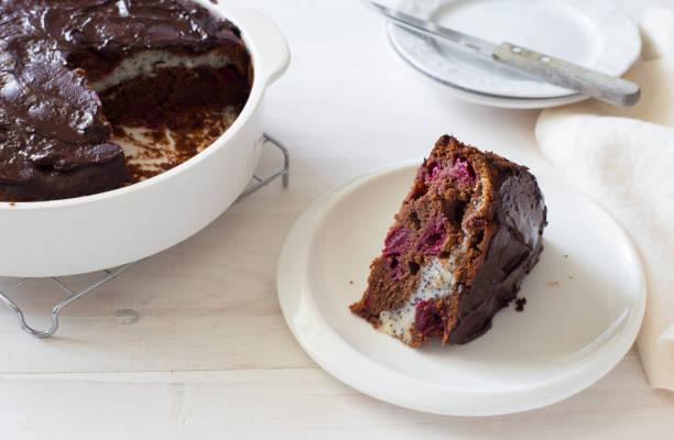 Homemade chocolate, cheese and cherries cake closeup stock photo