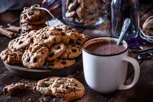 homemade chocolate chip cookies and hot chocolate mug - hot chocolate stock photos and pictures