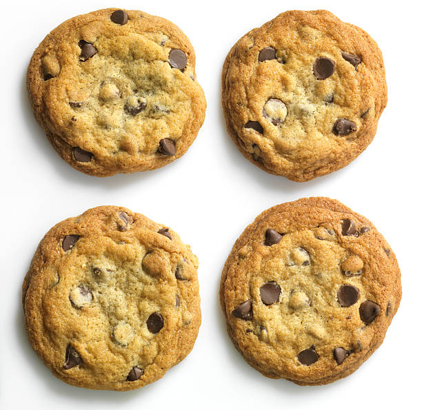 Homemade Chocolate Chip Cookies on white, overhead  chocolate chip cookie stock pictures, royalty-free photos & images