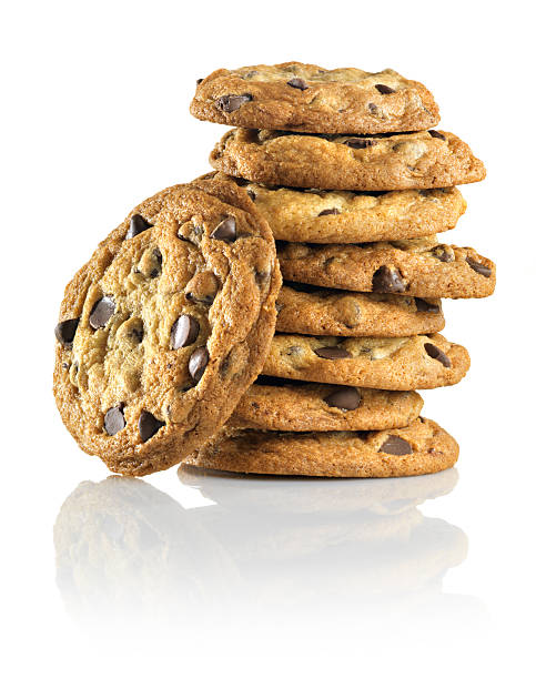 """Homemade Chocolate Chip Cookies, stack, reflection """"Tall Stack of homemade chocolate chip cookies on a white background with a reflective shadow. These are the real homemade cookies, made from scratch and baked at the studio. Shot with a 39 megapixel back on a medium format camera."""" burwellphotography stock pictures, royalty-free photos & images"""