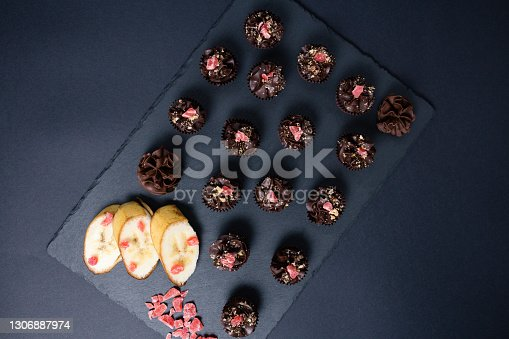Chocolate candies on a black background