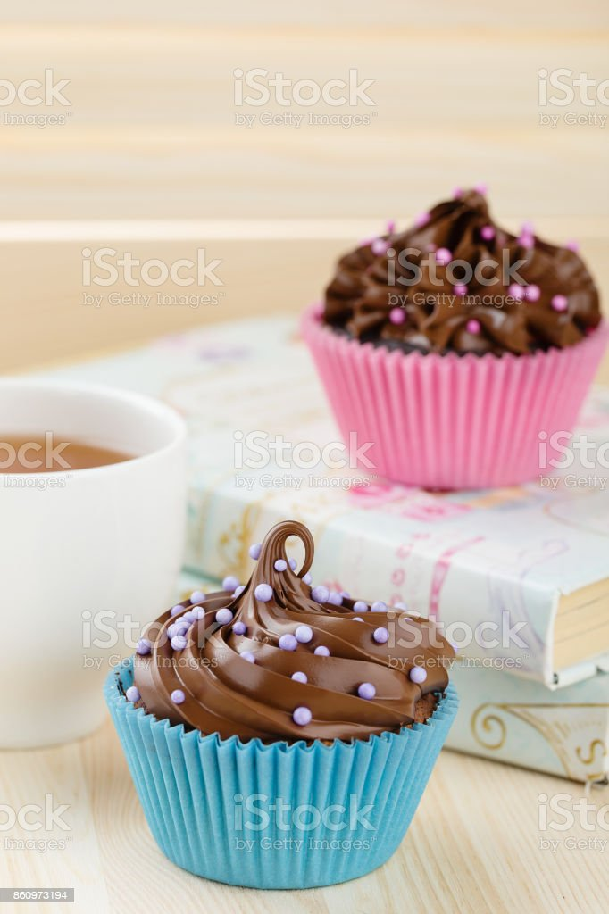 Homemade chocolate cupcakes with sprinkles stock photo