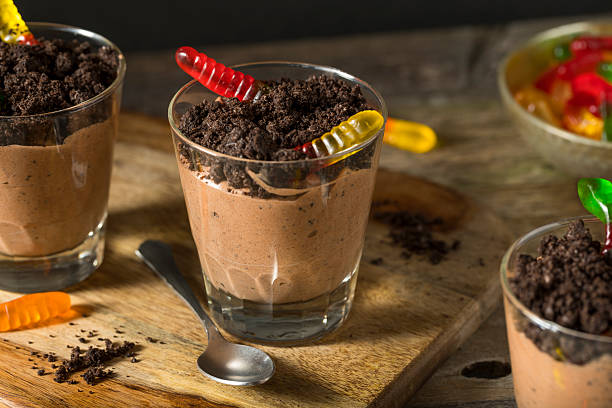 Homemade Chocolate Dirt Pudding Homemade Chocolate Dirt Pudding with Gummy Worms pudding stock pictures, royalty-free photos & images