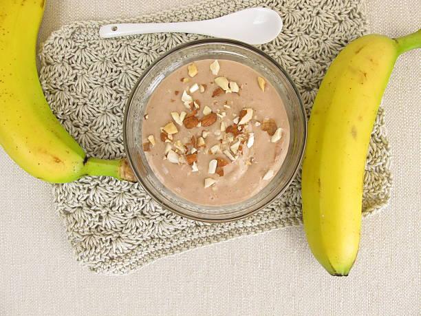 homemade chocolate ice cream with frozen bananas, cocoa and almonds - bananeneis stock-fotos und bilder