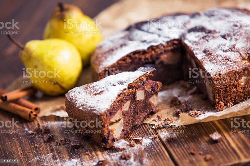 Homemade chocolate pie with pears and cinnamon stock photo