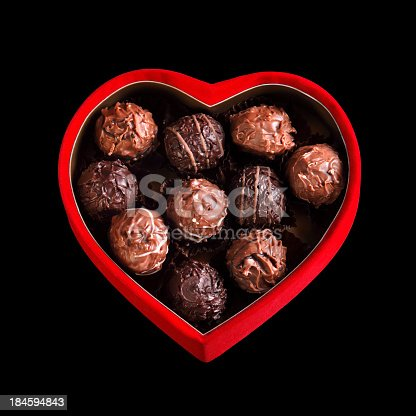 183269671 istock photo homemade chocolates in heart shaped red box 184594843