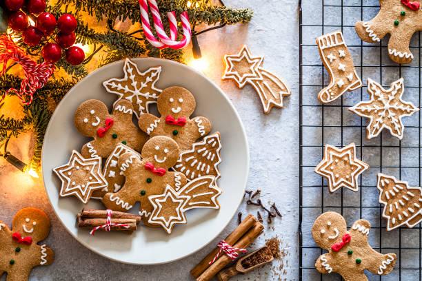 homemade christmas cookies on gray table - christmas cookies imagens e fotografias de stock