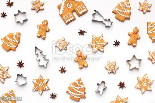 istock Homemade christmas cookies on white background, top view 1064150748