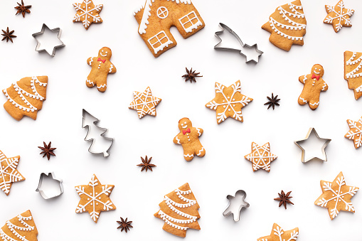 Christmas pattern. Various gingerbread cookies and forms on white background, top view