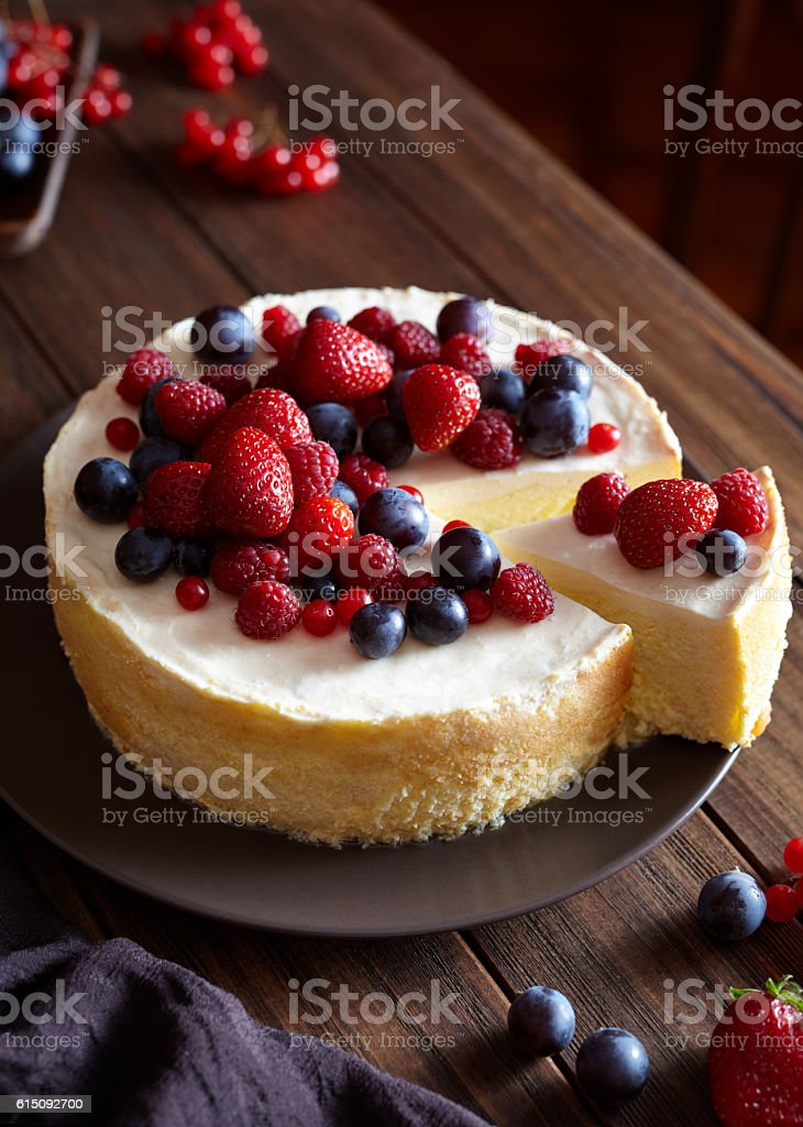 Homemade Christmas winter berry fruit cheesecake on wooden dark table stock photo