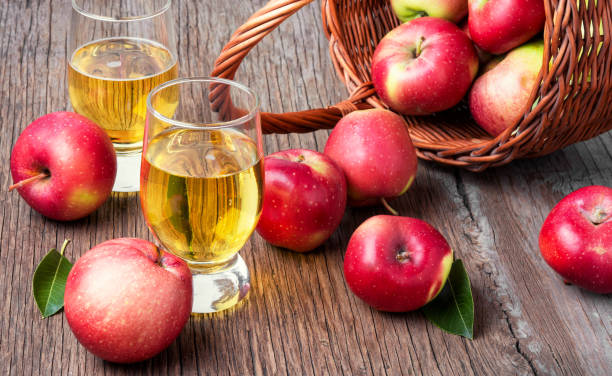 Homemade cider from ripe apples Apple cider with fresh apples on rustic background.Apple cider cocktail hot apple cider stock pictures, royalty-free photos & images