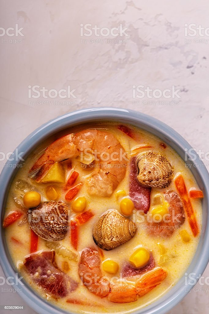 Homemade clam chowder with shrimps. stock photo