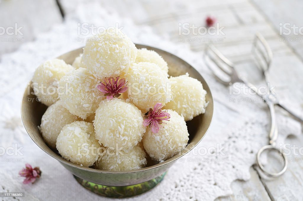 Homemade coconut bites in metal bowl royalty-free stock photo