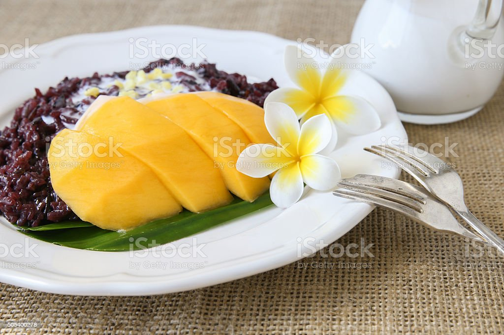 Homemade coconut black sticky rice with mango, selective focus stock photo