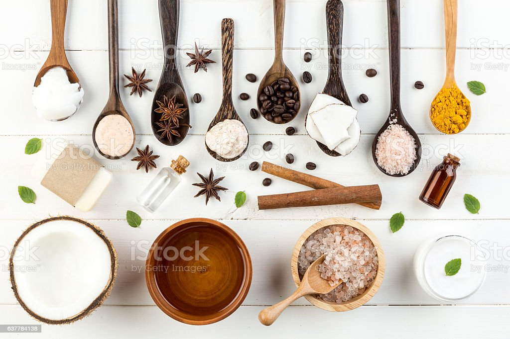 Homemade coconut products on white wooden table background. Oil, stock photo