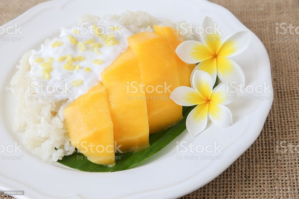 Homemade coconut sticky rice with mango, selective focus stock photo