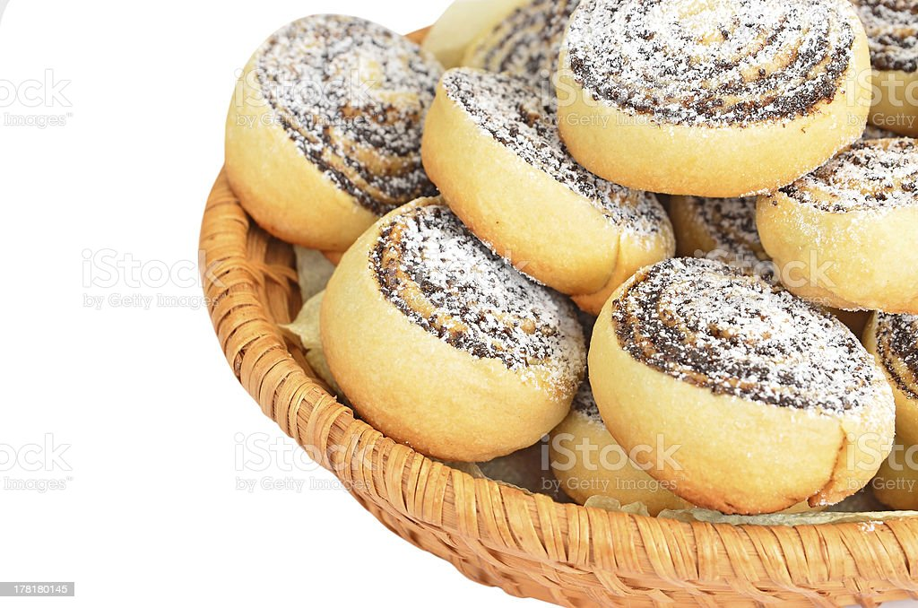 Homemade cookie roll with poppy in a wattled basket royalty-free stock photo