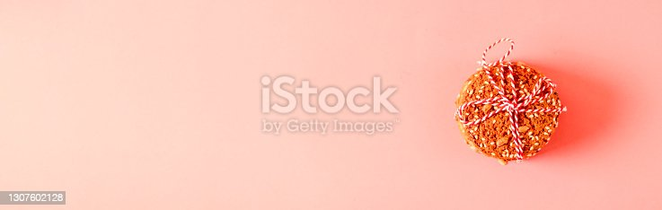 istock Homemade cookies on pink background. Minimal composition. Flat lay, top view, copy space. Healthy and healthy breakfast 1307602128